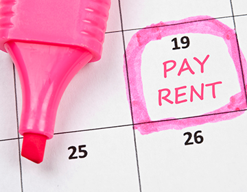 Why is guaranteed rent crucial for landlords and property investors?